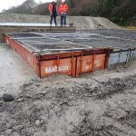 Shipping containers inserted below ground