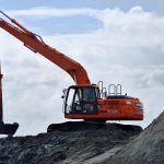 Digger hauling dredge material