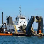 Dredging vessel in the sea