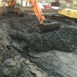 Digger mixing dredge material