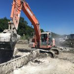 LockedIn® being performed on hazardous dredge by being mixed by a digger
