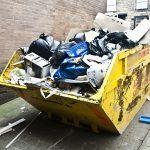 Yellow skip full of waste