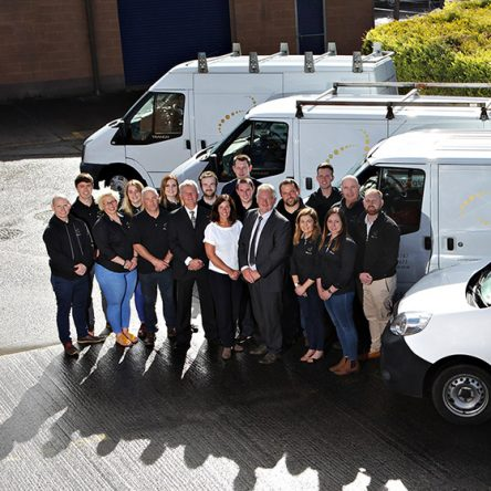 ATG Group staff pictured with ATG vans