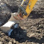 Digger excavating soil