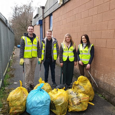 ATG Staff pictured with multiple bags of litter after performing a litter pick