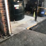 New oil tank location with fresh tarmac being laid