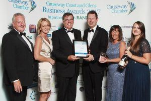 At the Causeway Coast and Glens Business Awards 2017 the Social Enterprise of the Year winners award presented by Sharon and Bruce Bailey of McDonalds to Ashes to Gold with Alastair Christie, Jacqui, Lauren and Dr Mark McKinney. 023Chamber Award winners 2017