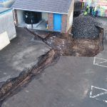 Drone image of school playground excavated along the oil pipe line
