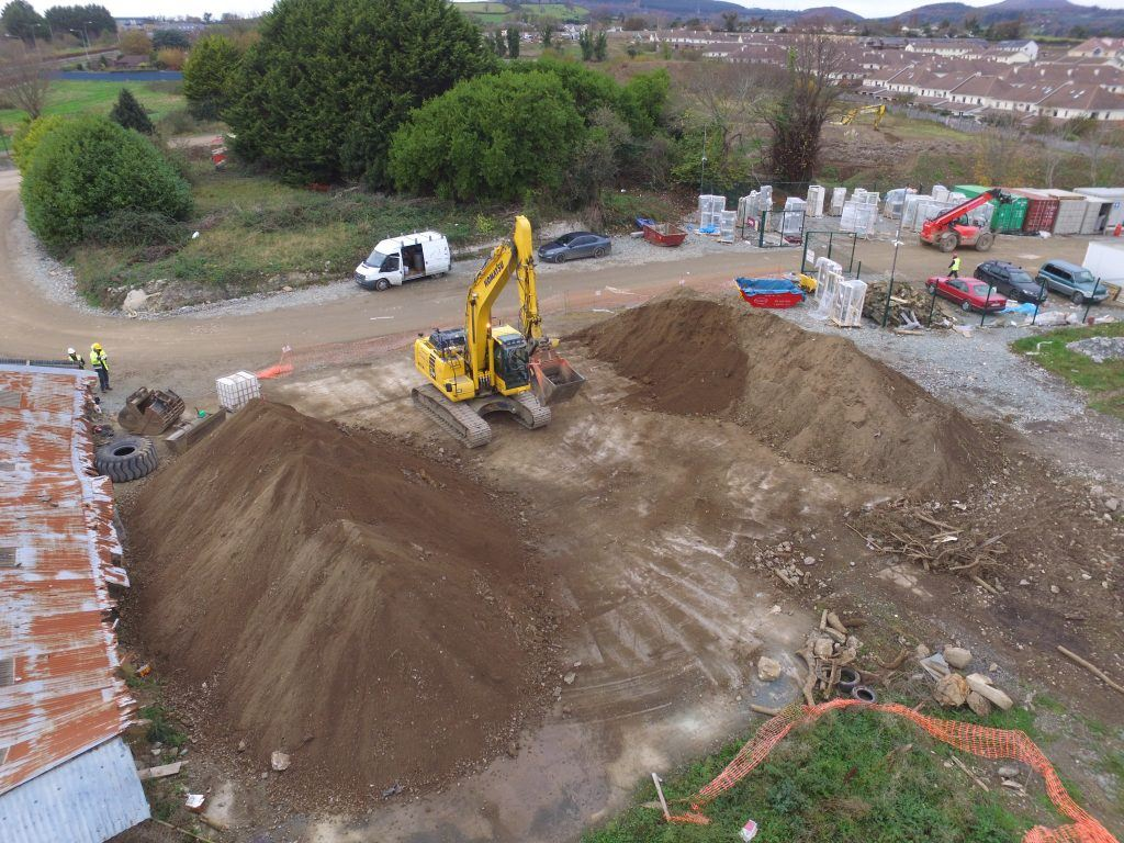 Drone image of a site in Wicklow where Eraginate was performed, showing mounds of clean soil and a digger