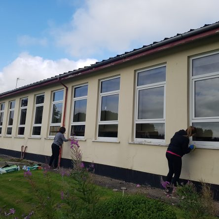 ATG staff helping to paint a local primary school