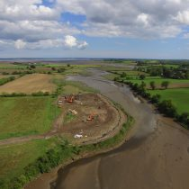 Aerial photo showing the site condition at the start of the project and the River Enler running adjacent