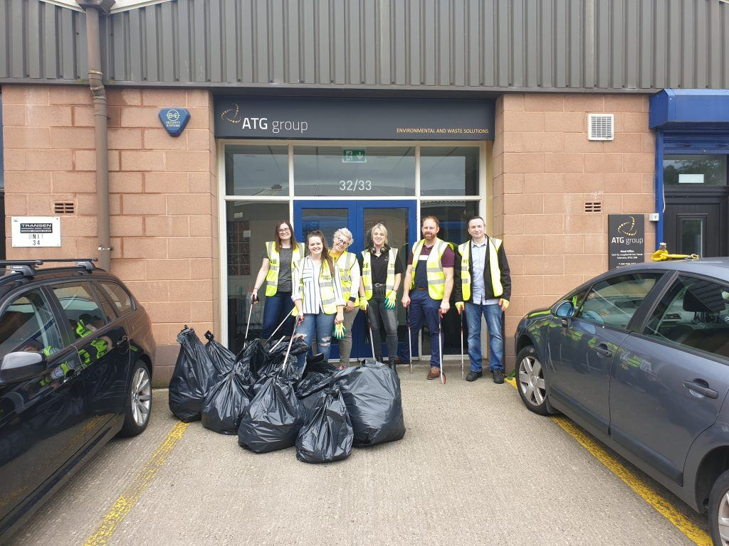 Some of our Coleraine team pictured outside our offices with their litter pickers and 12 bin bags full of litter